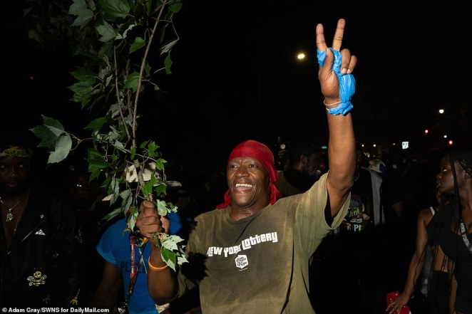 A reveler takes part in the J'Ouvert celebrations in Brooklyn in the early morning hours of Monday