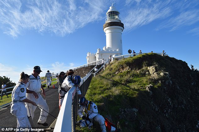 A massive land, sea and air search uncovered no clues as to the 18-year-old's whereabouts (pictured, searchers at Byron Bay lighthouse back in 2019)