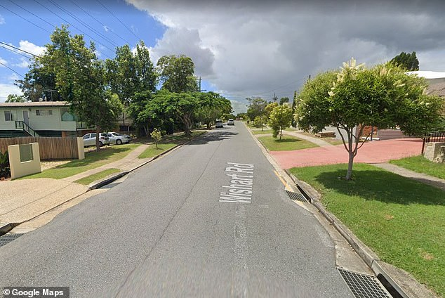 A woman was found dead inside a home on Wishart Road (pictured),Upper Mount Gravatt, just before 8pm on Monday
