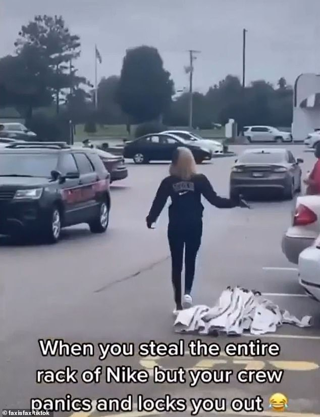 Giving up, the woman drops the rack of pants on the ground as the driver speeds away