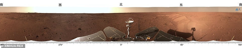 The stunning 360-degree view of Zhurong's vantage point on Mars shows the rover's solar arrays and antenna amid the dusty red soil.Zhurong is surveying Utopia Planitia - a large plain in the planet's northern hemisphere - for signs of water or ice that could lend clues as to whether Mars ever sustained life