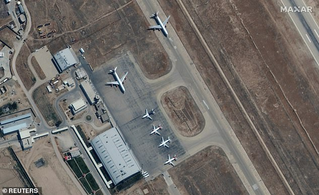 In the north of the country, six planes are seen on the tarmac at Mazar Sharif Airport in Afghanistan, amid claims a blunder by the US State Department has prevented them from evacuating Americans and Afghan visa holders