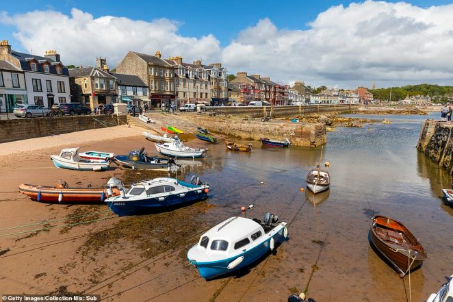 The isle of Great Cumbrae is popular for tourists. Pictured: Millport harbour, Great Cumbrae, Firth of Clyde, Scotland