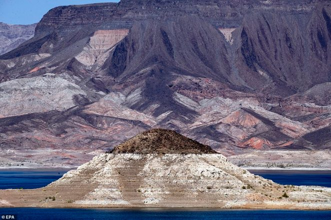 A view of the white rings of where the water level once was within Lake Mead, as viewed from the Lake Mead National Recreation Area near Boulder City, Nevada, USA, 20 August 2021