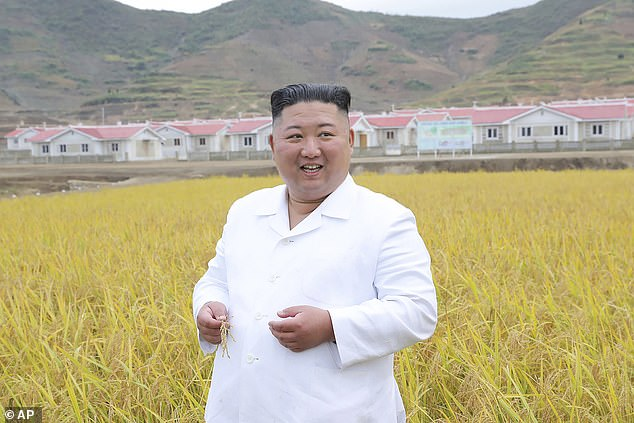 During the meeting held on Thursday, Kim said the 'disastrous weather' is becoming more pronounced worldwide. 'Our country is also lying vulnerable to its danger,' Kim said. Pictured: Kim visits a flood-hitborder village in Kimhwa County, Kangwon Province, North Korea
