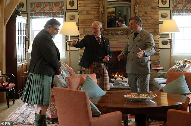 Michael Fawcett (right) with Charles on royal duties in Scotland in 2019 with Lord Thurso (left)