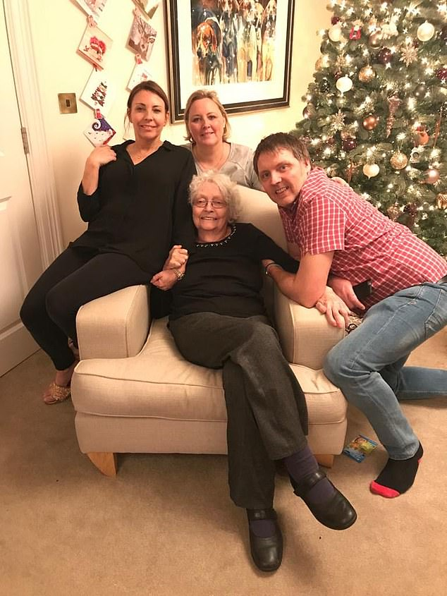 In 2017, Barbara (pictured, seated) had a stroke and the next year she was put into social care and daughterHolly (centre) has an outstanding debt of £100,000 for her mother's care