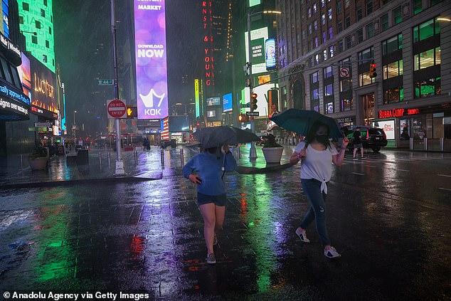 People flee heavy rain as Hurricane Ida slammed into New York City on Wednesday after wreaking havoc across the country