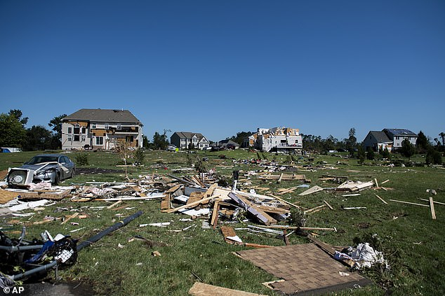 Debris covers the yard of a house in New Jersey that was damaged by Hurricane Ida overnight on Wednesday