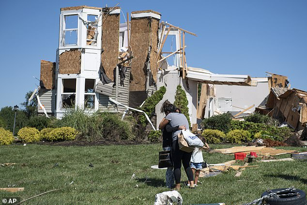 A resident is embraced by her mother after her home was severely damaged when Hurricane Ida slammed into New Jersey on Wednesday