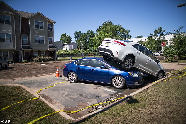 Cars were pushed onto of one another overnight on Wednesday as Hurricane Ida slammed into New Jersey