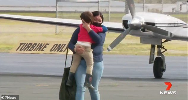 The mother's plea comes just days after Queensland family Dominique Facer and Mick Francis and son Memphis, 3, were finally reunited after two months apart because of the Covid-19 border closures. (Pictured, Memphis and mother Dominique reunite on the airfield tarmac)