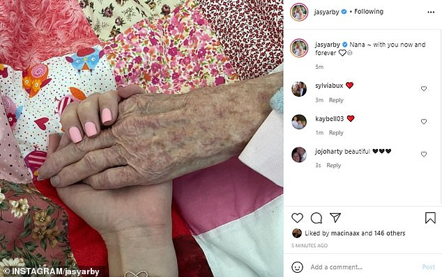 'Nana, with you now and forever': Jasmine shared a photo of her holding her grandmother's hand in hospital earlier this month