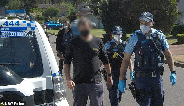 The man was arrested at a home in Leonay, in Sydney's west on Monday and will appear in Penrith Local Court on Tuesday (pictured, the accused man being arrested)