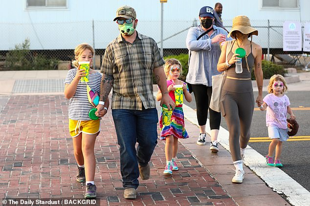 Stepping out: His other daughters Pearl, nine, and Andy, six, could be seen walking alongside him and Aree, who wore a floppy sunhat and matching green active wear