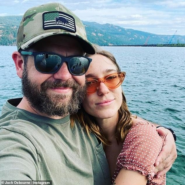 Time away: Jack and his girlfriend Aree recently enjoyed a break together in the wilderness, posing together for a picture by a lake