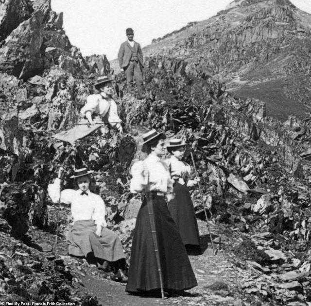 Strenuous: A walking party on Mount Snowdon in Wales in 1895. The four women are seen dressed in long skirts and buttoned blouses, whilst a man behind them stands in a three-piece suit and cap
