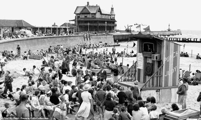A timeless tradition: Children watch a Punch and Judy show at 'Children's Corner' on Lowestoft beach in Suffolk in 1952