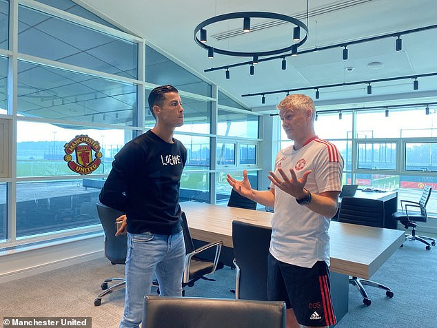 Cristiano Ronaldo bizarrely wore a jumper during a mini heatwave for his trip to Carrington