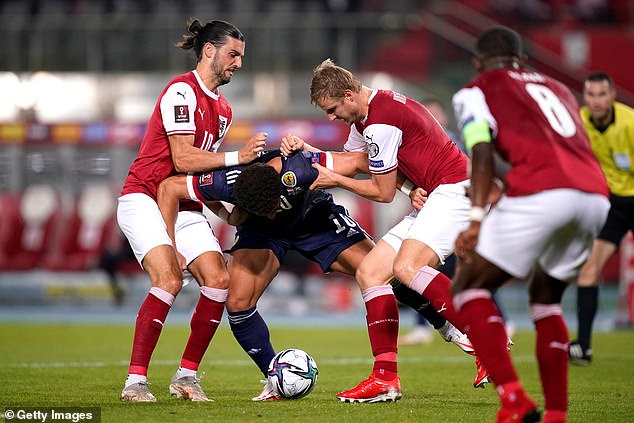 Scotland striker Adams went to ground while grappling with defender Martin Hinteregger