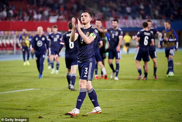 Andy Robertson applauds supporters following Scotland's famous 1-0 victory in Austria