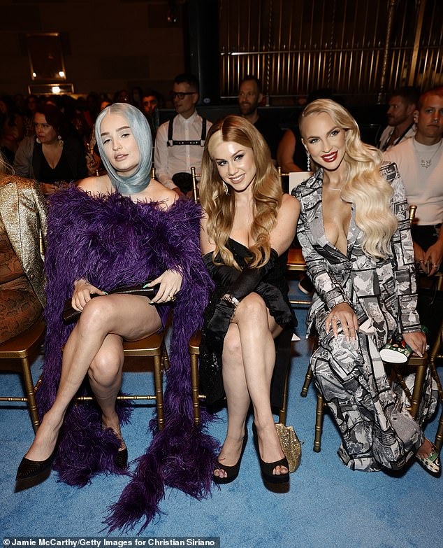You can't sit with us: Christine held court at the Siriano show - where Marina and the Diamonds performed - beside singers Kim Petras (L) and Slayyyter (M), not far from rap legend Lil Kim