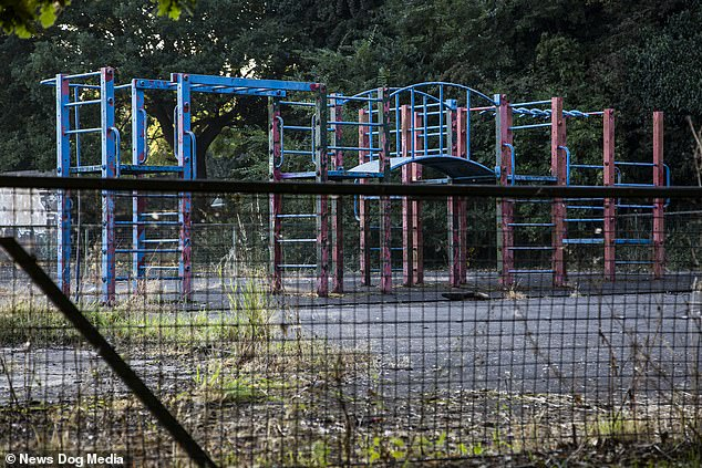 Pictured: This playground in the Solihull area of the West Midlands has been compared to Chernobyl by residents who say its a disgrace it's been allowed to fall into a state of disrepair