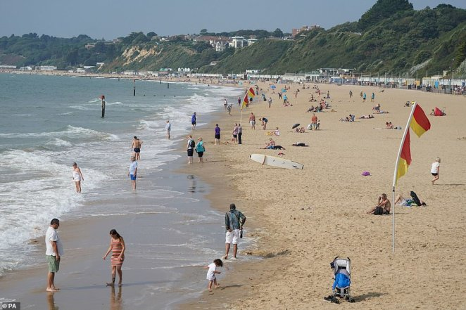 Thousands are set to head to parks and beaches to lap up the final 86F rays of summer. Pictured: Crowds start to gather at Bournemouth Beach, Dorset