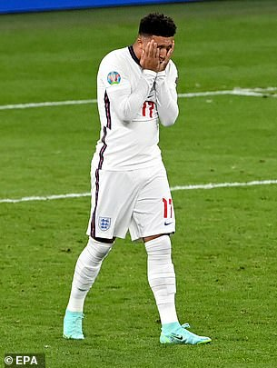 Jadon Sancho puts his head in his hands after he failed to score in the penalty shoot out in Euro 2020 final