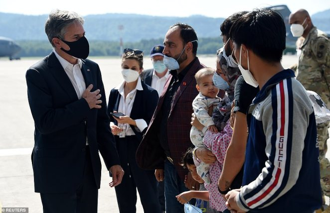 Blinken speaks with refugees who fled Afghanistan and are now waiting processing at the Ramstein Air Base on Wednesday before being transported to a final resettlement destination in the U.S.