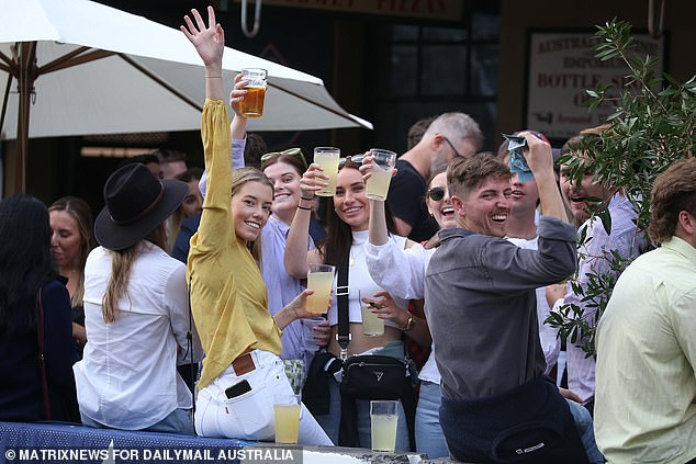 Under plans agreed to during a crisis cabinet meeting on Wednesday, millions in NSW will finally lose the shackles of lockdown on October 18 - providing the 70 per cent fully-vaccinated target is met (pictured, pub-goers in Sydney's The Rocks on Anzac Day 2021)