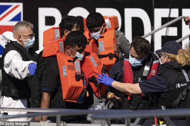 A group of migrants are brought into Dover docks by Border Force this afternoon