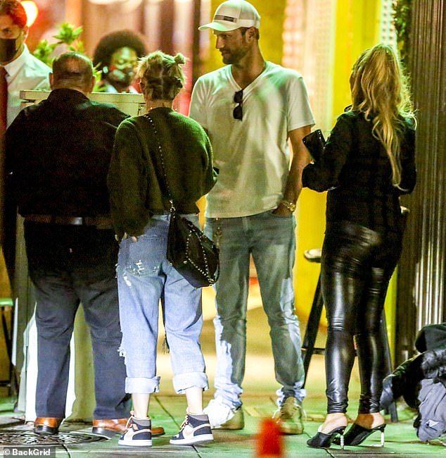 Winding down: After they had finished their meal, the former couple stopped outside the restaurant to chat with Davitian and a blond woman in all black