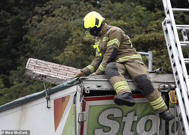 The rear of the vehicle suffered extensive damage and bricks could be seen still lying on the roof of the truck's trailer