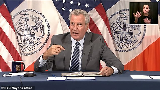 New York City mayor Bill de Blasio said in a press conference Tuesday that the city is 'turning the corner when it comes to public safety,' citing dipping crime rates and one of the safest Augusts in nearly 30 years