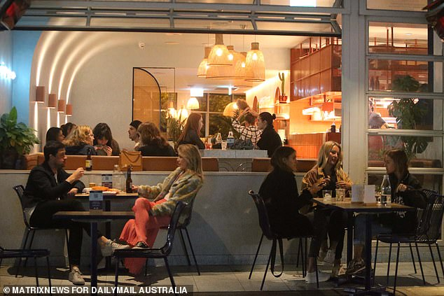 Under the 'vaccine passport' plan set to be formally announced on Thursday at 11am, double-dosed residents - including those in the 12 LGAs areas of concern - will be given a wide range of new freedoms (pictured, diners at a Bondi eatery when restrictions eased in June last year)