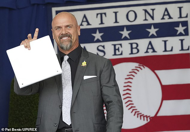 Hall of Famer Larry Walker waves while being introduced on Wednesday in Cooperstown