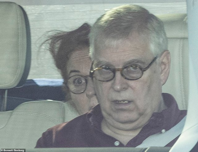 Prince Andrew is pictured with Sarah Ferguson in the back seat of the Range Rover as they left Windsor