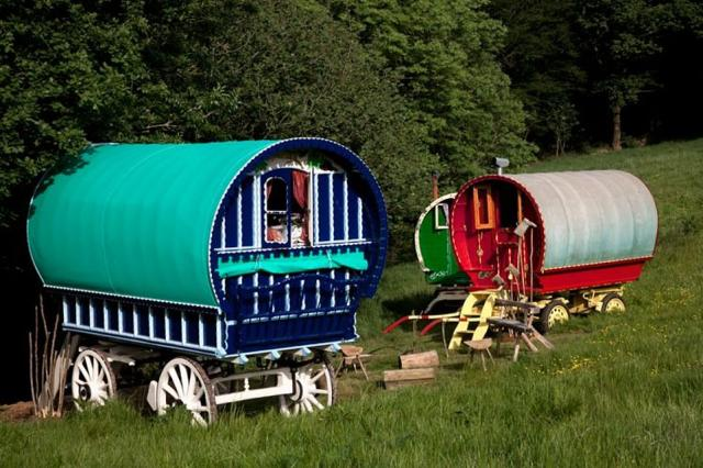 NO 13. FISHERTON FARM'S VINTAGE VARDOS, ATHERINGTON, DEVON: Guests sleep invardos (traditional, intricately decorated bow-top gipsy wagons) with names like Big Ted and Red Rum when they stay at Fisherton Farm - a 100-acre working farm. The average cost of a single night's stay is £230