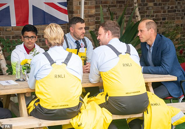 During the afternoon, he could be seen speaking with members of the RNLI crew while sitting at a picnic table