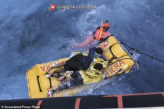 Dramatic footage shows a rescuer swimming with a raft to the coastguard vessel off the island on Thursday morning