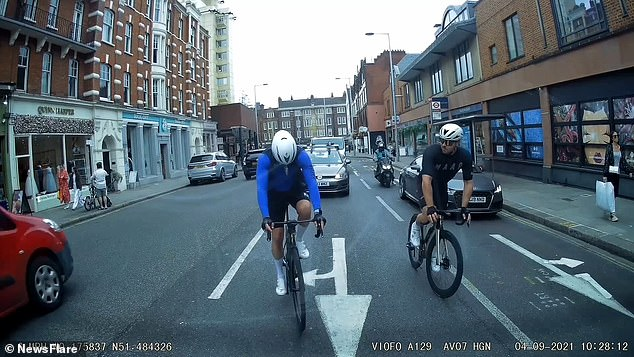 A cyclist came to crashing halt into the back of a stationary car after getting distracted by his pedals in Chelsea, London, on Saturday