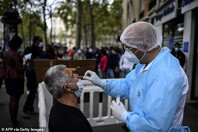 The gesture was made to thank them for serving the nation during Covid-19,the governmernt said on Thursday. Pictured: A man has a PCR test in Paris in August