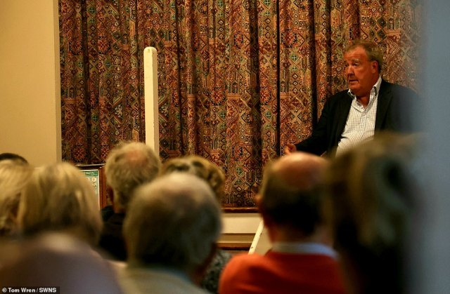 Jeremy Clarkson addresses a town hall meeting called to discuss his farm shop - and was given the middle finger by one local