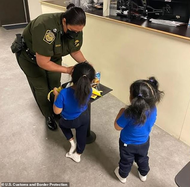 El Paso Sector Chief Patrol Agent Gloria Chavez provides snacks to the two girls from Ecuador who were abandoned by human smugglers and dropped over a 14-foot high border wall in New Mexico on March 30