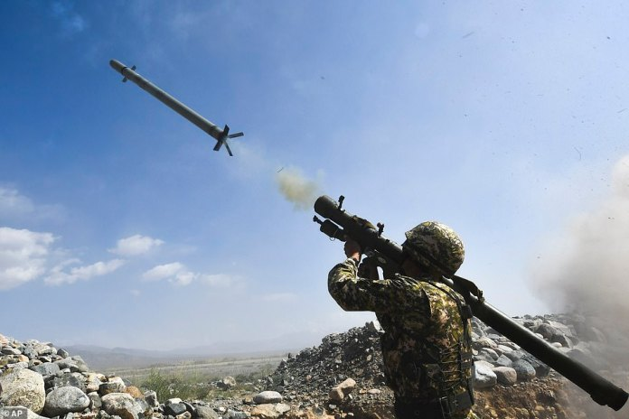 A Kyrgyzstan's soldier shoots from a portable air-defence system during a joint military exercises with Belarus and Russia at the Edelweiss training ground near the Kyrgyz capital, Bishkek