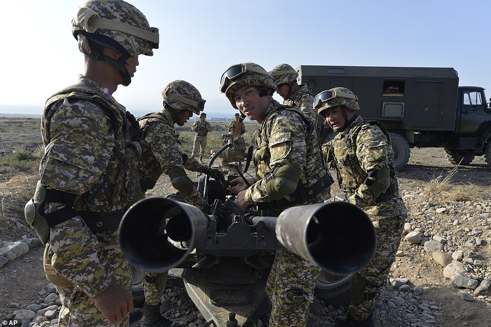 Kyrgyzstan's soldiers prepare an anti-aircraft weapon during joint military exercises that have alarmed NATO months after a military build-up by Ukraine nearly sparked a crisis