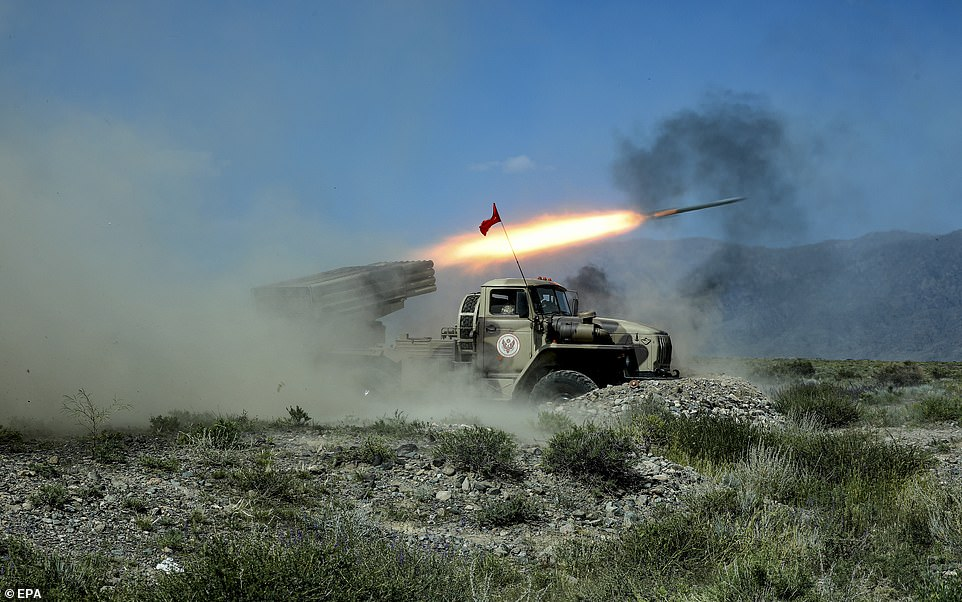 A Kyrgyz BM-21 Grad multiple launch rocket system launches rockets during joint military exercises with Russia and Belarus