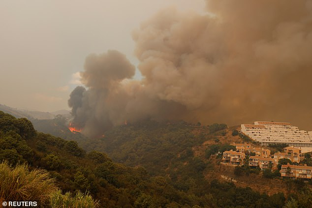 Pictures showed a plume of black smoke drifting from the mountains down into the Mediterranean