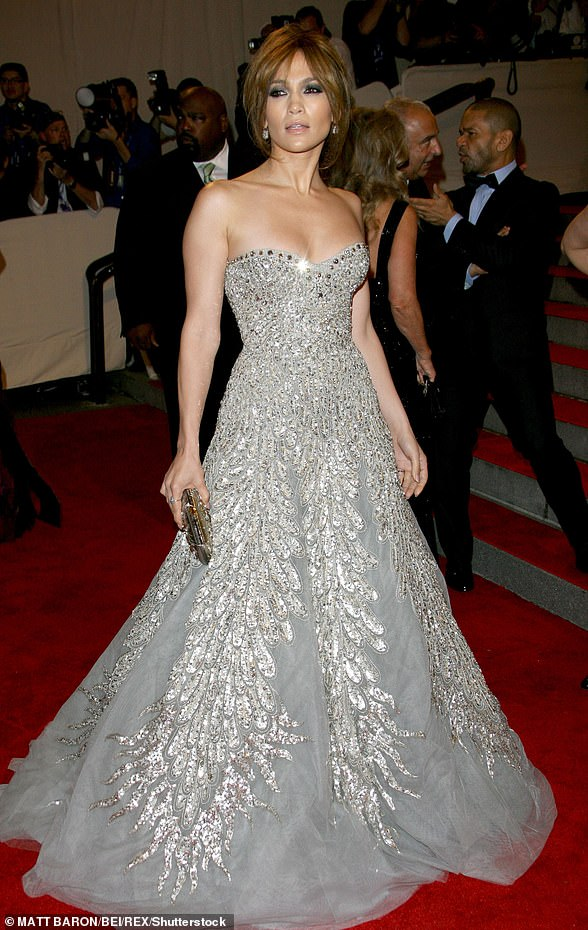 In 2010:This year the Back-Up Plan star returned to Hollywood glamour with a sparkly strapless silver Cinderella style dress as she wore her hair up